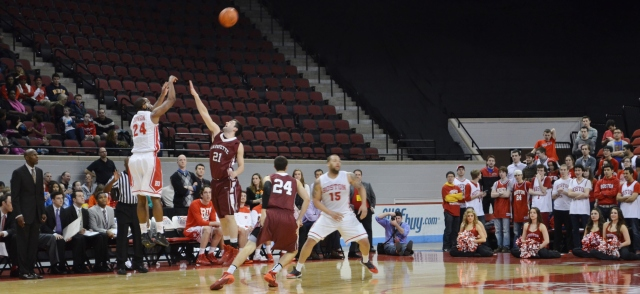 Travis Robinson makes one of his four three-pointers in Wednesday's game. (Beanpot Hoops photo)