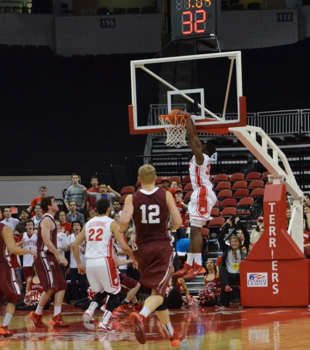 Justin Alston finishes an alley-oop from Maurice Watson, Jr. in the second half at Agganis Arena. (Beanpot Hoops photo)