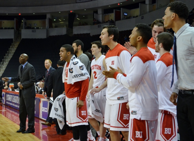 Maurice Watson, Jr. (red shirt) and BU's bench celebrate during the second half of a Patriot League semifinal victory over Army. (Beanpot Hoops photo)