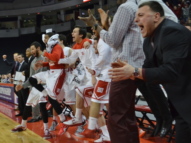BU's bench erupts after Justin Alston's putback dunk in the second half of Saturday's 91-70 win over Army.